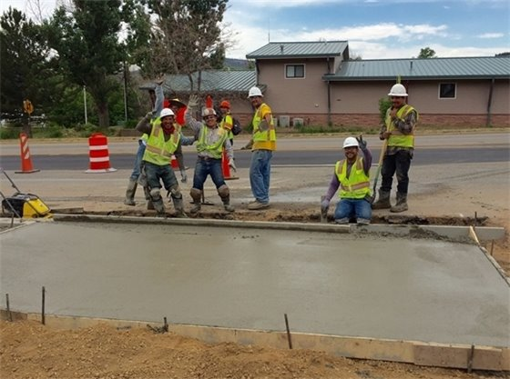 Crew Pouring Driveway